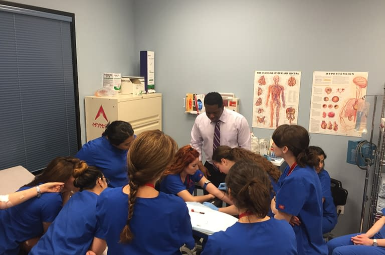 ATA College Medical Assistant Students Practicing in Lab